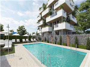 Schoene 2 Zimmer Wohnung mit Fussbodenheizung und Pool zu verkaufen